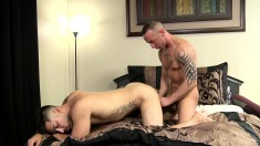 Two Tattooed Musclemen Warm Up With Oral And Anal Sex In Bed