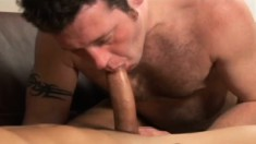 Bald headed hunk gets his long cock sucked and stroked by his partner