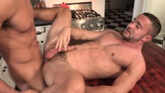 Two horny hunks cook up an orgasm with sizzling oral and anal sex in the kitchen